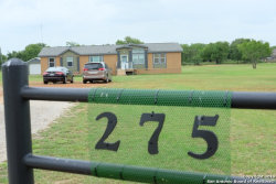 Photo of 275 S Meadow Dr, Lytle, TX 78052 (MLS # 1399215)