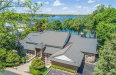 Photo of 4500 ORCHARD TRAIL CRT, Orchard Lake, MI 48324 (MLS # 21292657)