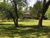 Photo of 1700 MIDDLE RD, Highland, MI 48357 (MLS # 21304804)