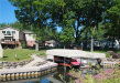 Photo of 3440 E CLARICE AVE, Highland, MI 48356 (MLS # 21351918)