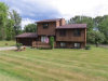 Photo of 119 PENINSULA LAKE DR, Highland, MI 48357 (MLS # 21353260)