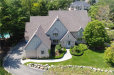 Photo of 1649 SCENIC HOLLOW DR, Rochester Hills, MI 48306 (MLS # 21358401)