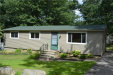 Photo of 530 WOODRUFF LAKE DR, Highland, MI 48357 (MLS # 21358683)