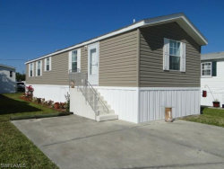 Photo of 56 Oyster Bay LN, Fort Myers Beach, FL 33931 (MLS # 216013322)