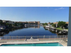Photo of 1942 Beach PKY, Unit 207, Cape Coral, FL 33904 (MLS # 217053123)