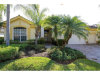 Photo of 8761 Hideaway Harbor CT, Naples, FL 34120 (MLS # 217054957)