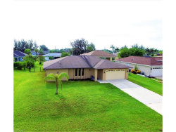 Photo of 2529 SW 15th PL, Cape Coral, FL 33914 (MLS # 217071440)