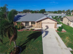 Photo of 1044 SE 23rd AVE, Cape Coral, FL 33990 (MLS # 218015908)