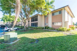 Photo of 6494 Royal Woods DR, Unit 7, Fort Myers, FL 33908 (MLS # 218039294)