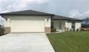 Photo of 2529 NW 20th AVE, Cape Coral, FL 33993 (MLS # 218062421)