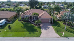 Photo of 130 SE 30th TER, Cape Coral, FL 33904 (MLS # 218076903)