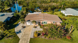 Photo of 1729 Club House RD, North Fort Myers, FL 33917 (MLS # 219008734)