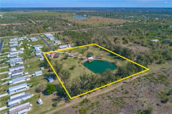 Photo of 29171 Edgewood ST, Punta Gorda, FL 33982 (MLS # 219029672)