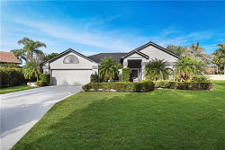 Photo of 12521 Woodtimber LN, Fort Myers, FL 33913 (MLS # 219043700)