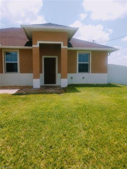 Photo of 905 NW 15th PL, Cape Coral, FL 33993 (MLS # 219046833)