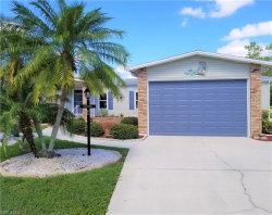 Photo of 10107 Turnberry Isle CT, North Fort Myers, FL 33903 (MLS # 219047920)