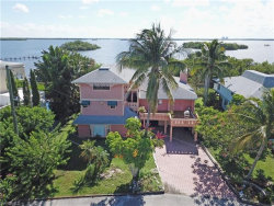 Photo of 21521 Widgeon TER, Fort Myers Beach, FL 33931 (MLS # 219048781)