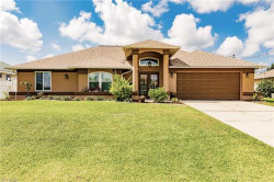 Photo of 2318 SW 31st LN, Cape Coral, FL 33914 (MLS # 219054832)