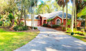 Photo of 4240 Silver Sword CT, North Fort Myers, FL 33903 (MLS # 219055671)
