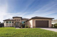 Photo of 1221 SW 24th ST, Cape Coral, FL 33991 (MLS # 219060110)