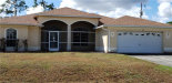 Photo of 423 E Poinsettia AVE, Lehigh Acres, FL 33972 (MLS # 219065180)