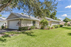 Photo of 14837 Crooked Pond CT, Unit 18, Fort Myers, FL 33908 (MLS # 219069405)