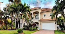 Photo of 11771 Isle Of Palms DR, Fort Myers Beach, FL 33931 (MLS # 220004840)