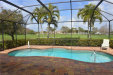 Photo of 10430 Curry Palm LN, Fort Myers, FL 33966 (MLS # 220013192)