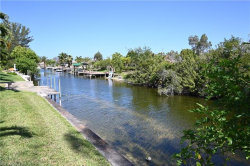 Photo of 605 SW 21st ST, Cape Coral, FL 33991 (MLS # 220029373)