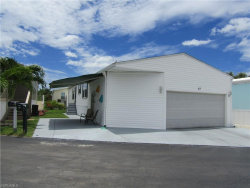 Photo of 57 Oyster Bay Lane, FORT MYERS BEACH, FL 33931 (MLS # 220044967)