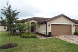 Photo of 9029 Triangle Palm Lane, FORT MYERS, FL 33913 (MLS # 220059804)
