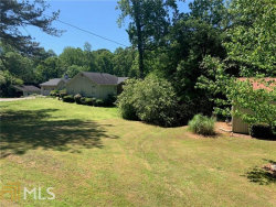 Photo of 13040 Cogburn Rd, Unit 205-9, Milton, GA 30004 (MLS # 8866118)