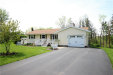 Photo of 141 Sherwood Drive, Parma, NY 14468 (MLS # R1118900)