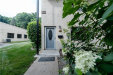 Photo of 102 Bay Village Drive, Unit 102, Irondequoit, NY 14609 (MLS # R1281282)