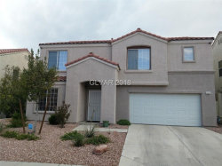 Photo of 10001 RANCH HAND Avenue, Las Vegas, NV 89117 (MLS # 2013132)