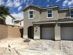 Photo of 5396 BLUSTERY TOWNS Avenue, Las Vegas, NV 89118 (MLS # 2063689)