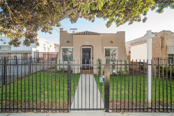 Photo of 1814 W 65th Place, Los Angeles, CA 90037 (MLS # DW19274743)