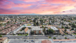 Photo of 10400 Downey Avenue, Unit 203, Downey, CA 90241 (MLS # DW20008056)