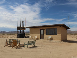 Photo of 7213 Wit's End Way, 29 Palms, CA 92277 (MLS # EV19154605)