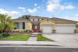 Photo of 12601 Longhorne Drive, Eastvale, CA 92880 (MLS # IV20066935)