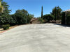 Photo of 7590 Fairway Drive, Yucca Valley, CA 92284 (MLS # IV20120350)