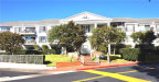 Photo of 300 Cagney Lane, Unit 115, Newport Beach, CA 92663 (MLS # IV20241952)