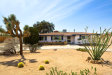 Photo of 7380 Avalon Avenue, Yucca Valley, CA 92284 (MLS # JT18083154)