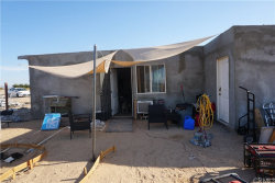 Photo of 560 Bluegrass Avenue, 29 Palms, CA 92277 (MLS # JT19218740)