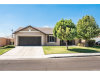 Photo of 7671 Indian Canyon Circle, Eastvale, CA 92880 (MLS # PW18247212)