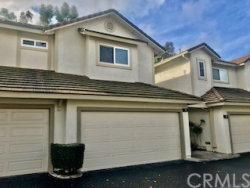 Photo of 5847 E Rocking Horse Way, Unit 9, Orange, CA 92869 (MLS # PW20011827)