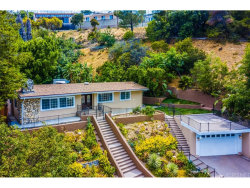 Photo of 17856 Cathedral Place, Encino, CA 91316 (MLS # SR17166783)