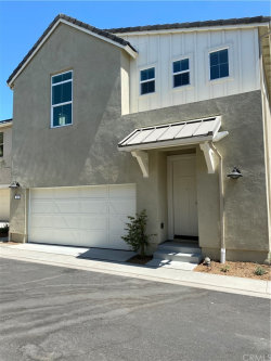 Photo of 4232 Powell Way, Unit 103, Corona, CA 92883 (MLS # SW20159980)
