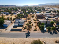 Photo of 6431 Fortuna Avenue, Yucca Valley, CA 92284 (MLS # JT19202307)