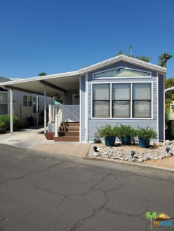 Photo of 69801 Ramon Road, Unit 235, Cathedral City, CA 92234 (MLS # 19500772PS)